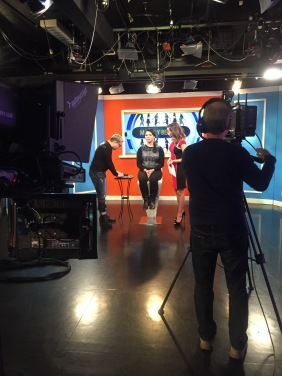 """Behind the scenes of Gabriela modeling for Telemundo 47's """"Acceso Total"""" beauty segment."""