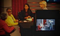 """Behind the scenes with Director of """"Rutgers Around the World"""" Georgette Timoney, far right, before Gabriela Milian, second from the right, begins an interview with Dr. Renée Larrier, far left, and Dr. Carolyn Brown, second to the left, discussing the Center for African Studies."""