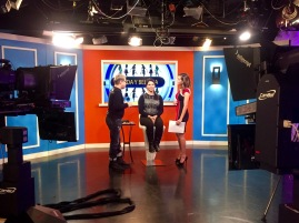 "Behind the scenes of Gabriela modeling for Telemundo 47's ""Acceso Total"" beauty segment."